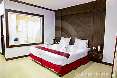 Interior of a room in hotel. Large bed.