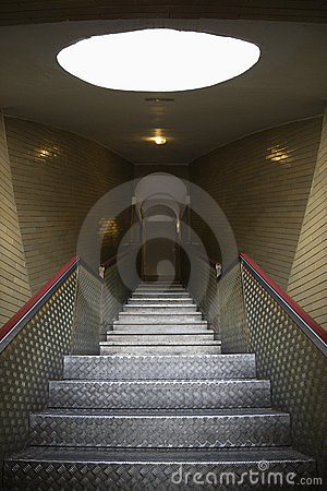 Interior stairs leading to door.