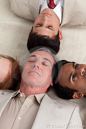 International Business team lying on the floor