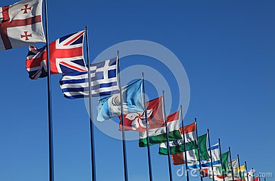 International flags on sky background