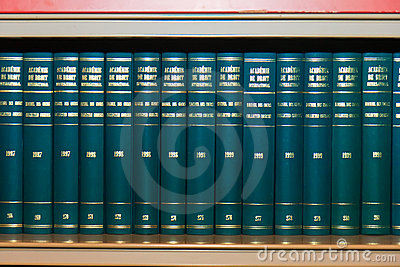 International Law Books in Bookshelf Editorial Image