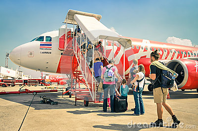 International tourist people boarding Airasia flight in Bangkok airport