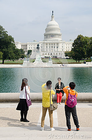 International Tourists pose in front of Congress d Editorial Photography