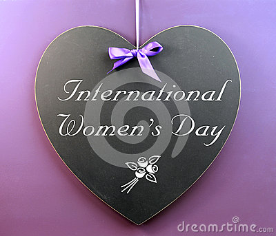 International Women s Day message written on heart shape blackboard