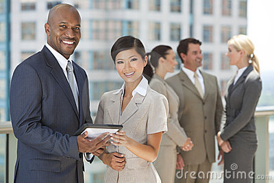 Interracial Business Team with Tablet Computer