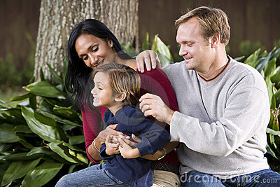 Interracial family with cute five year old boy