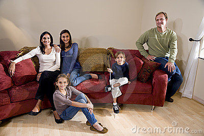 Interracial family of five on living room couch
