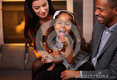Interracial family having fun at home smiling