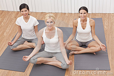 Interracial Group of Beautiful Women Yoga Position