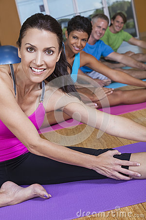 Interracial Group of People Practicing Yoga