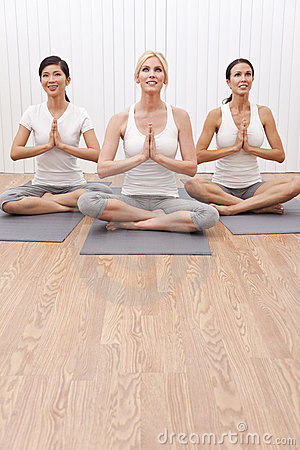 Interracial Group of Three Women In Yoga Position