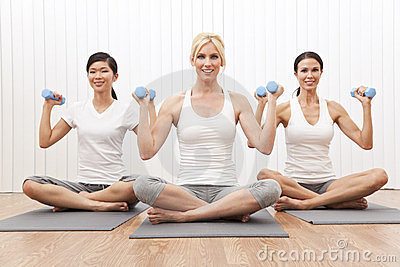 Interracial Yoga Group Women Weight Training
