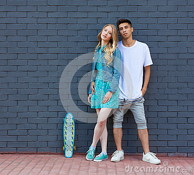 Free Interracial Young Couple In Love Outdoor Whis Skateboard. Stunning Sensual Outdoor Portrait Of Young Stylish Fashion Couple Posing Stock Photo - 58421620