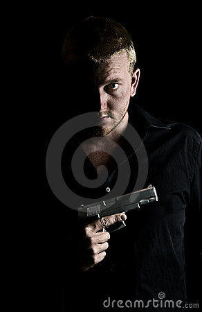 Intimidating Male Holding a Gun to his Chest