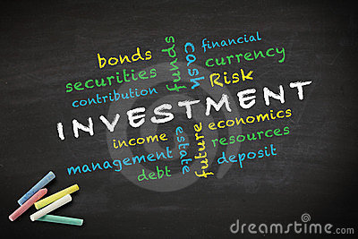 Investment concept written on blackboard