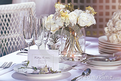 Invitation card on outdoor wedding table