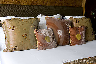 Inviting bed with many big soft cushions