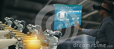 Iot industry 4.0 concept,industrial engineer using smart glasses with augmented mixed with virtual reality technology to monitorin Stock Photo