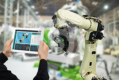 Iot industry 4.0 concept,industrial engineer using software augmented, virtual reality in tablet to monitoring machine in real t Stock Photo