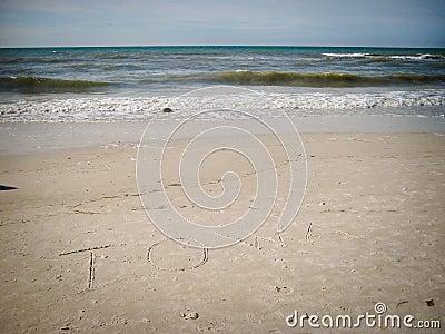 Iowa written in sand