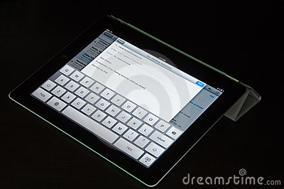 IPad2 with Smart Cover is used to compose an eMail Editorial Stock Photo