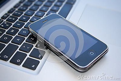 IPhone 3GS και Macbook υπέρ Εκδοτική εικόνα