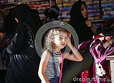 Iranian girl against veiled women Editorial Stock Photo