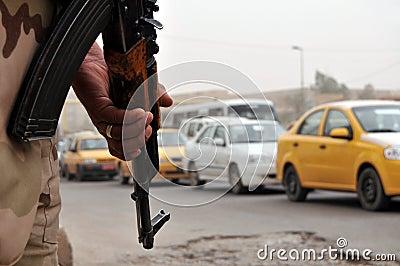 Iraqi soldier at roadblock