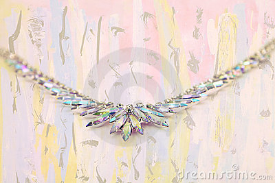 Iridescent crystal necklace on fine art background