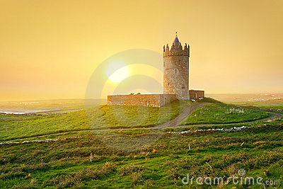 Irish castle on the hill at sunset