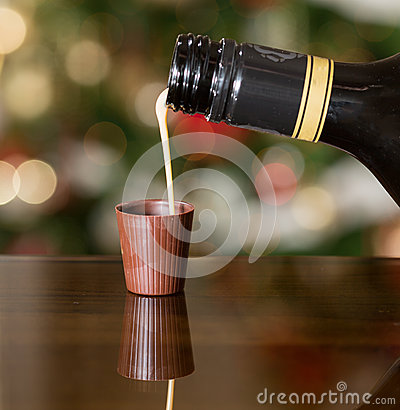 Free Irish Cream Liqueur Pouring Into Chocolate Royalty Free Stock Photography - 28334937