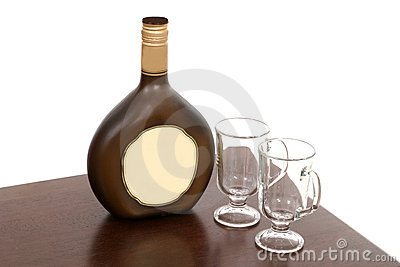 Irish Creme Bottle and Two Empty Glasses