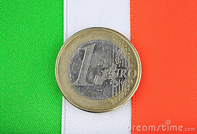 Irish flag with one euro coin.