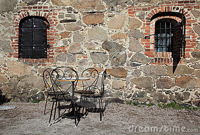 Iron chairs and table in traditional backyard