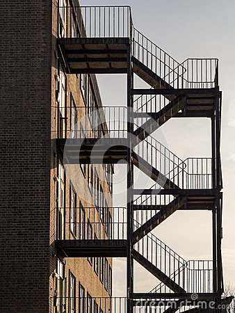 Free Iron Fire Escape On Exterior Of Brick Built Square Building Stock Photos - 85048163