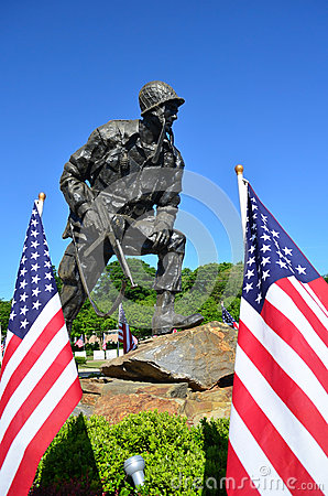 Iron Mike US Paratrooper American Flags Editorial Image