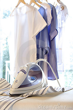 Free Iron On Ironing Board With Clothes Hanging Royalty Free Stock Photo - 10764775