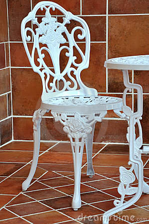 Iron table and chair in carving
