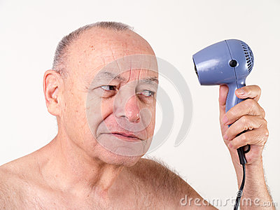 Ironic - Bald man using hair dryer