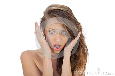 Irritated brunette model screaming looking at camera