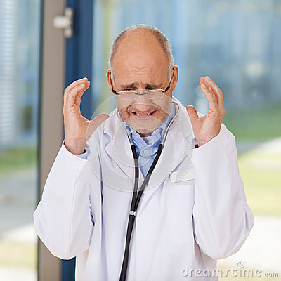 Irritated Doctor Gesturing In Clinic