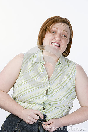 Irritated Obese Woman Unable To Button Jeans