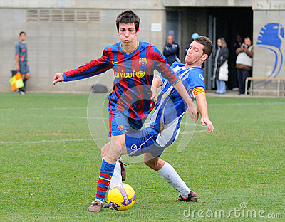 Isaac Cuenca (left), F.C. Barcelona youth team player, in action against RCD Espanyol