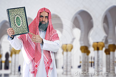 Islamic Arabian Shiekh presenting Quran
