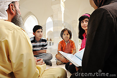 Islamic education inside white mosque,
