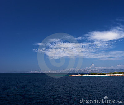 Island in Adriatic sea with beacon