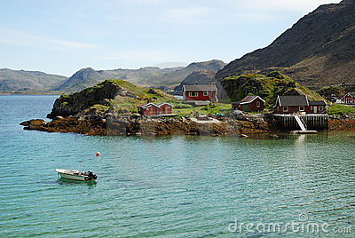 Island with fishing village in the middle of fjord