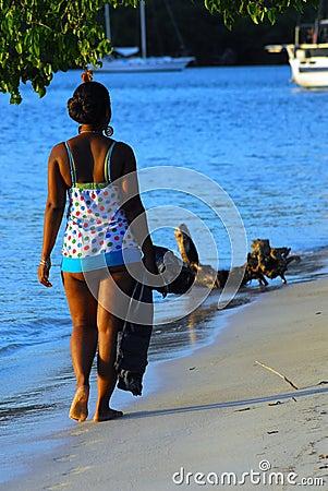 Island girl walking on beach