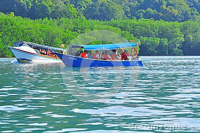 Island hopping boats to beautiful tropical island Editorial Photo