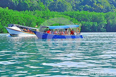 Island hopping boats to beautiful tropical island Editorial Stock Photo